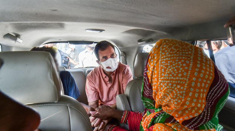 Congress leader Rahul Gandhi meets the family members of the minor girl who was allegedly raped and then murdered in Delhi cantt area, in New Delhi, Wednesday, August 4, 2021. (PTI /Arun Sharma)