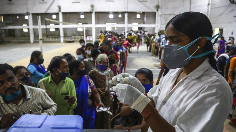 A health worker prepares to administer a dose of Covaxin as hundreds line up to receive their second dose of vaccine against the coronavirus at the municipal stadium in Hyderabad, July 29, 2021. (AP/Mahesh Kumar A.)