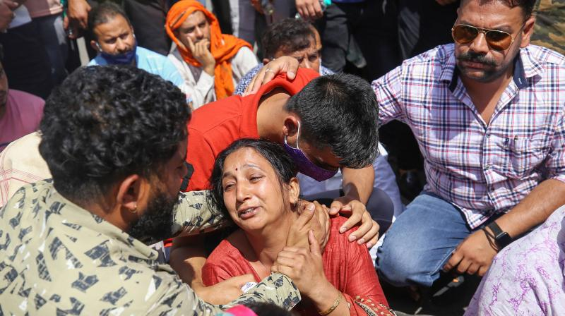 Sister of CRPF Commando Rakeshwar Singh Manhas reacts during a protest, demanding his release from the captivity of Naxals, in Jammu on April 7, 2021. (PTI)