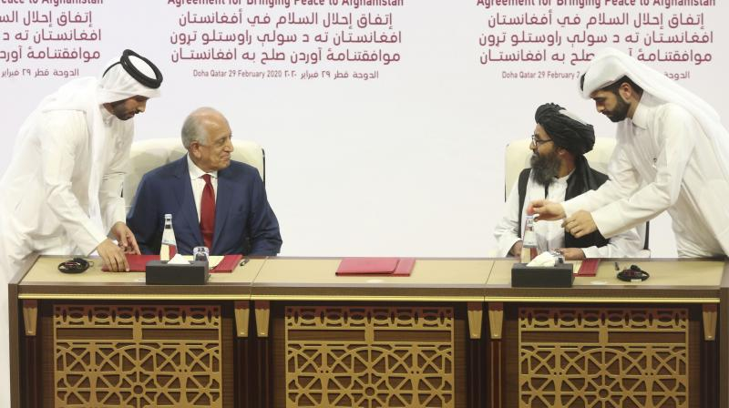 U.S. peace envoy Zalmay Khalilzad, left, and Mullah Abdul Ghani Baradar, the Taliban group's top political leader sign a peace agreement between Taliban and U.S. officials in Doha, Qatar. The Taliban say the long-awaited peace talks with the negotiating team selected by the Afghan government are to begin on Saturday, Sept. 12, 2020, in the Gulf Arab state of Qatar. The announcement on Sept. 10, came in a statement from the Taliban in Qatar, where the insurgents maintain a political office, and also as an announcement from Qatar's foreign ministry. (AP File)