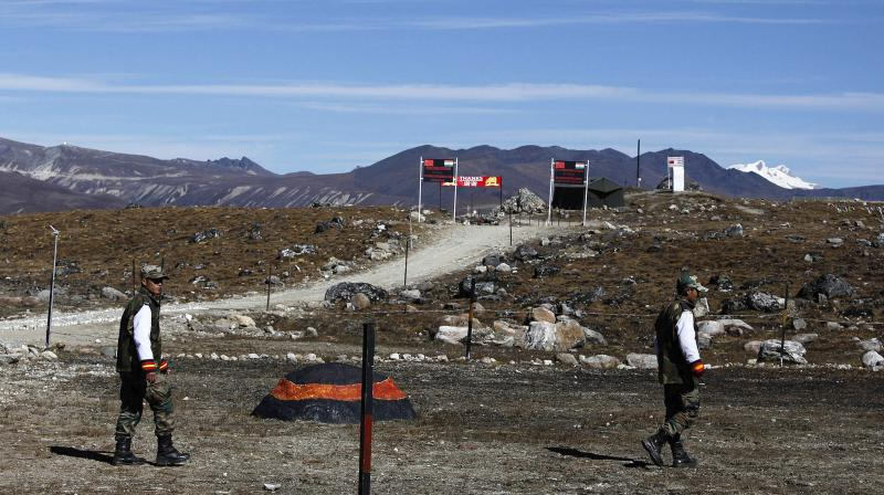 Indian army soldiers walk along the line of control at the India- China border. It has also been decided all security forces will remain at their respective locations all through the winter to deal with any Chinese threat.  (AP)
