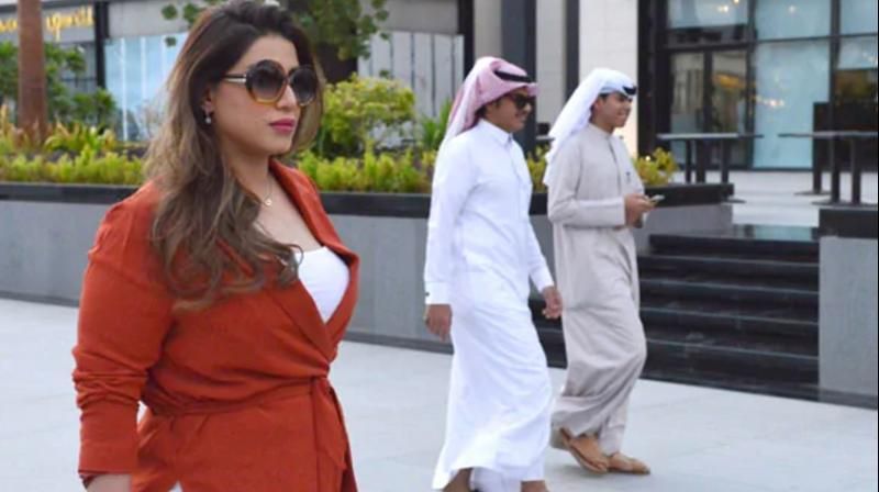 The 33-year-old human resources specialist strolled through a mall in central Riyadh last week wearing nothing but a burnt orange top over baggy trousers. (Photo: AFP)