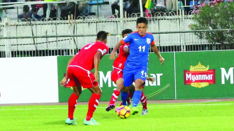Sunil Chhetri (right) in action against Myanmar in their AFC Asian Cup qualifiers in Yangon on Tuesday. India won 1-0 on Chherti's late goal.