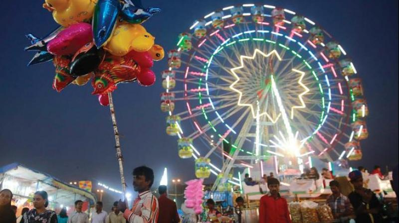 Anjli, 18 and Deepmala, 25, along with a few others from their family, rode the ferris wheel on the occasion of Teej festival at Hathikhana Temple ground in Ambala cantonment on Sunday evening. (Photo: File)
