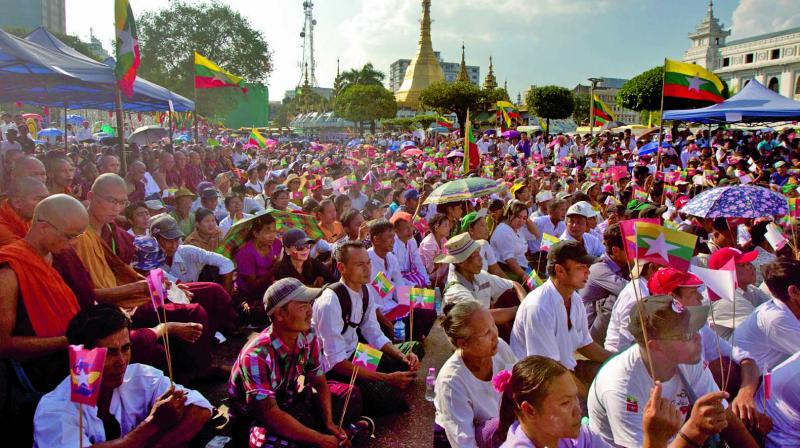 Participants attend a ceremony supporting the country's military and government servants in Yangon, Myanmar. (Photo: AP)