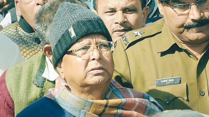 RJD chief Lalu Yadav on way to the special CBI Court in Ranchi.