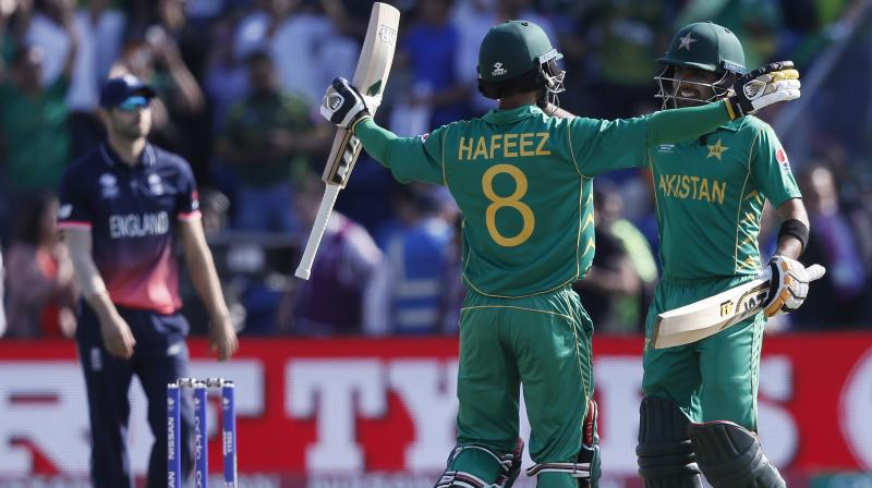 Pakistan's Mohammad Hafeez, left, and Pakistan's Babar Azam celebrate winning the ICC Champions Trophy semifinal cricket match between England and Pakistan at The Cardiff Stadium. (Photo: AP)