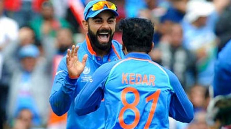 India's Kedar Jadhav, right, celebrates with his captain Virat Kohli after dismissing Bangladesh captain Mushfiqur Rahim. (Photo:AP)