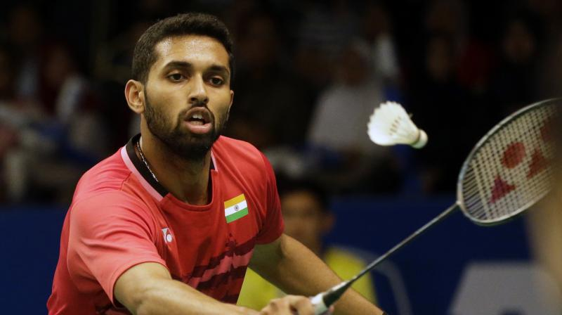 India's H.S. Prannoy plays against China's Chen Long during their men's singles quarter final match at Indonesia Open. (Photo: AP)