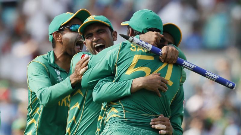 Teammates embrace Pakistan's captain Sarfraz Ahmed, back to camera after they defeated India during the ICC Champions Trophy final at The Oval in London. (Photo: AP)