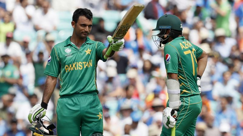 Pakistan batsman Fakhar Zaman, left, celebrates after scoring a half century with teammate Azhar Ali during the ICC Champions Trophy final between Pakistan and India. (Photo: AP)