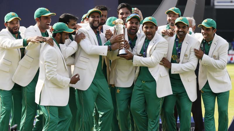 Pakistan players celebrate during the award ceremony for the ICC Champions Trophy at The Oval in London on  Sunday. (Photo:AP)
