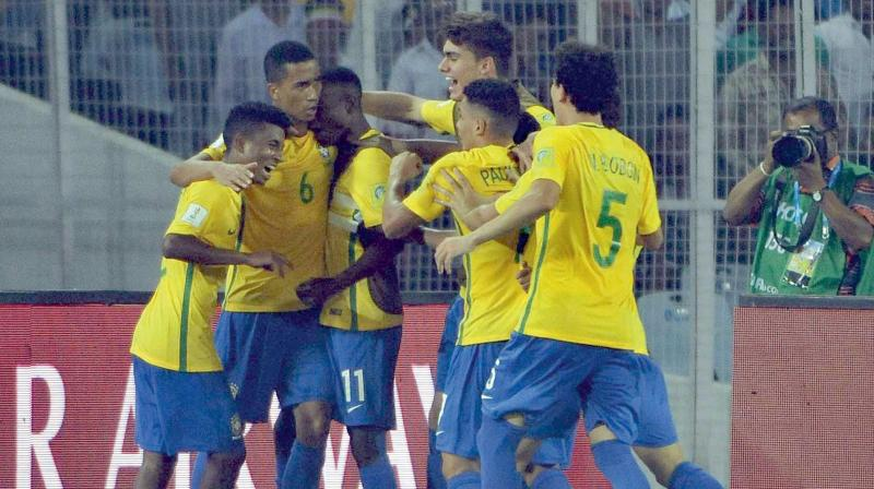 Brazil's Weverson (second from left) celebrates with team mates after scoring against Germany in their U-17 World Cup quarter-final in Kolkata on Sunday. Brazil won 2-1. (Photo: Pritam Bandyopadhyay)