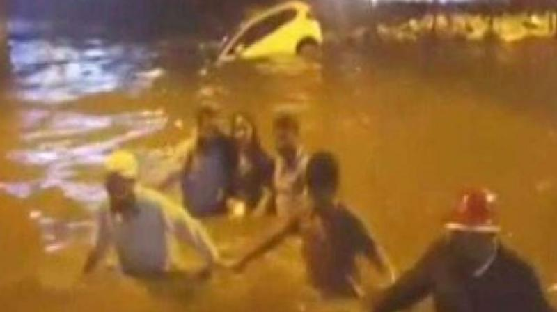 Five people jumped into the water and rescued the woman. (Photo: Screengrab)