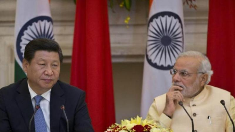 Chinese President Xi Jinping (L) and Prime Minister Narendra Modi (R). Chinese media said, 'India has repeatedly expressed its concern over the project since the project is located in disputed Kashmir, but it won't affect cooperation between China and Pakistan, because the ties are unshakable and will not target India.' (Photo: File | PTI)