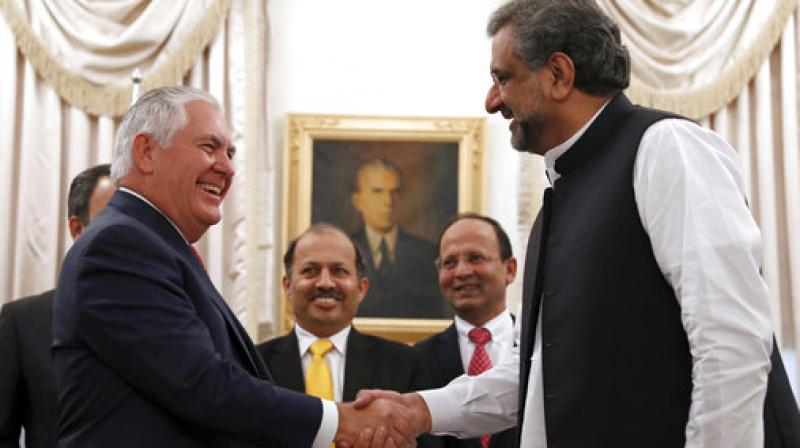 US Secretary of State Rex Tillerson shakes hands with Pak PM Shahid Khaqan Abbasi, before their meeting at the Prime Minister's residence on Tuesday in Islamabad. (Photo: AP)