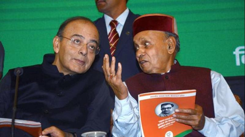 Union Finance Minister Arun Jaitley with former chief minister Prem Kumar Dhumal during launch of BJP Golden Vision document for the Assembly elections, in Shimla on Sunday. (Photo: PTI)