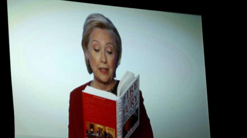 Clinton, who lost the 2016 election to Trump, read an excerpt from the book about Trump's eating habits. (Photo: AP)