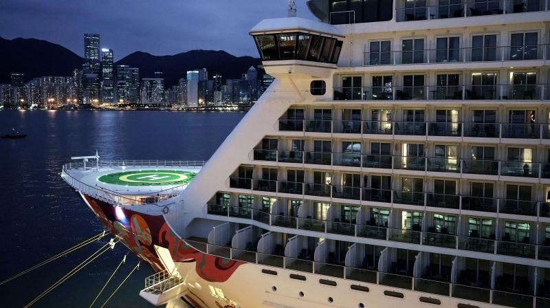 The cruise ship World Dream lies docked at the Kai Tak cruise terminal in Hong Kong, Saturday, February 8, 2020. The World Dream with approximately 1,800 passengers remained quarantined in Hong Kong's Victoria Harbour on Saturday. Several passengers from mainland China on a previous World Dream cruise were found to have the new coronavirus on returning home. (AP)