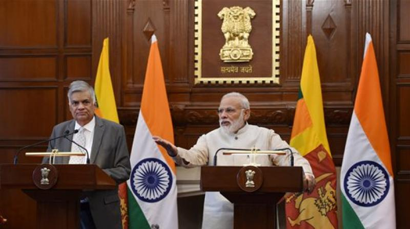 Prime Minister Narendra Modi with his Sri Lankan counterpart Ranil Wickremesinghe at the signing of an MoU between India and Sri Lanka on Cooperation in economic project at Hyderabad house in New Delhi on Wednesday. (Photo: PTI/Subhav Shukla)