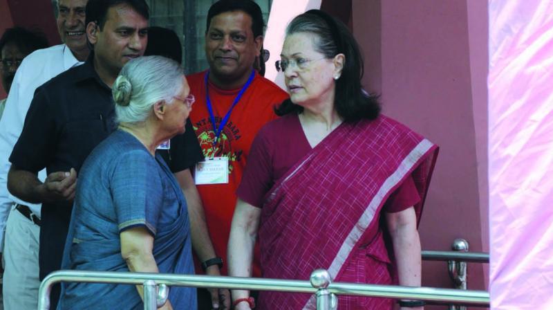 Sonia Gandhi with former Delhi CM Sheila Dikshit at a polling booth in New Delhi. (Photo: Sondeep Shankar)