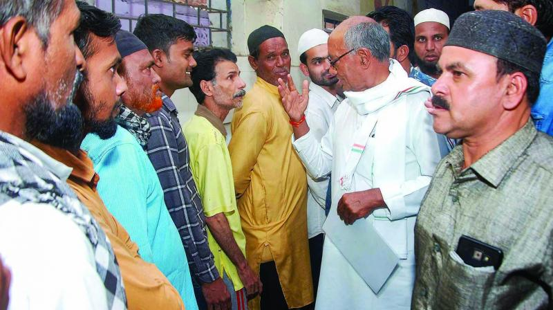 Congress candidate from Bhopal seat Digvijay Singh interacts with voters in Bhopal on Sunday. (Photo: PTI)