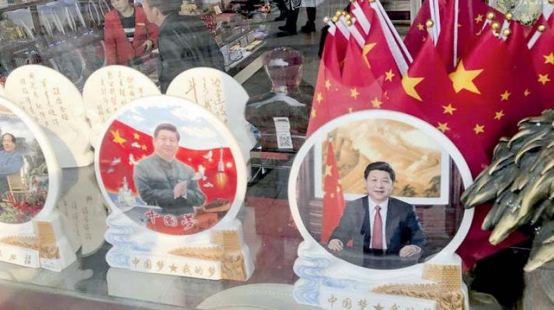 Memorabilia featuring Chinese President Xi Jinping are displayed at a souvenir shop in Beijing. (Photo: AP)
