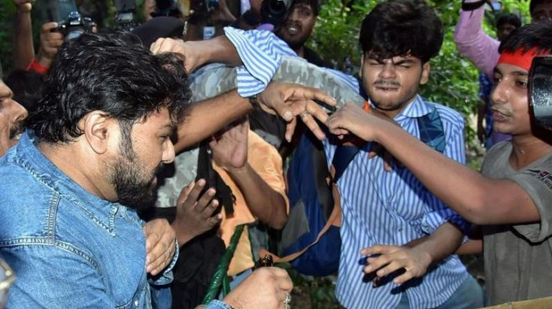 Babul Supriyo on Thursday was caught on camera being manhandled by the protesting students. There were visuals of a particular student pulling him by his hair. (Photo: ANI)