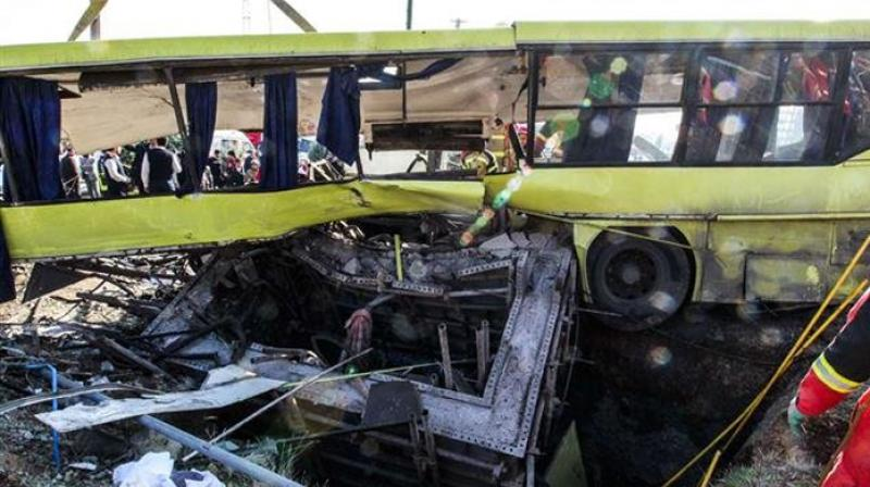 Pictures released by the news agency showed Red Crescent emergency workers searching through the wreckage of an overturned yellow bus. (Photo: AFP)