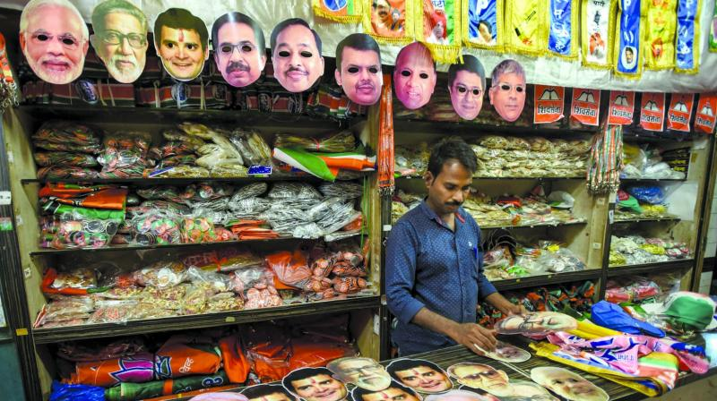 Local businessmen selling election-inpsired merchandise say business is poor, with people choosing to show their devotion for parties online rather than off it.