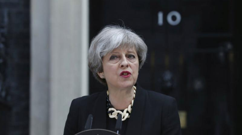 Theresa May sidestepped questions about how much Britain would pay to settle its EU financial accounts, saying talks will look 'ahead to the future deep and special partnership that I want with the European Union.' (Photo: AP)