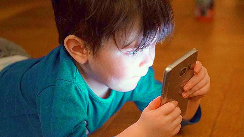 WHO recommends that children between two and four years of age should be restricted to spending at most one hour a day on electronic devices.