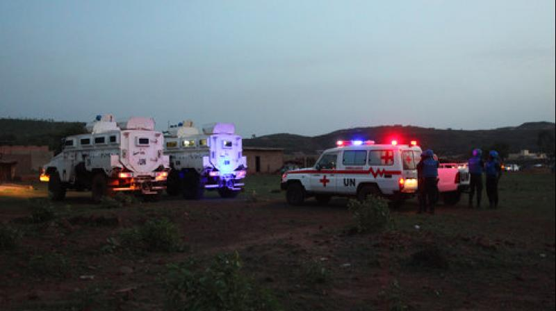 United Nations armored personnel vehicles are stationed with an ambulance outside Campement Kangaba, a tourist resort near Bamako (Photo: AP)