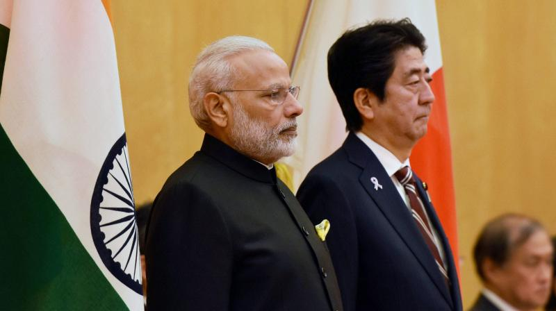 Prime Minister Narendra Modi with Japanese Prime Minister Shinzo Abe during his ceremonial welcome in Tokyo. (Photo: AP)