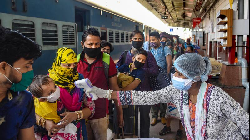 Migrants arriving from Mumbai undergo screening at Danapur Railway Station, during ongoing COVID-19 lockdown in Patna. PTI Photo