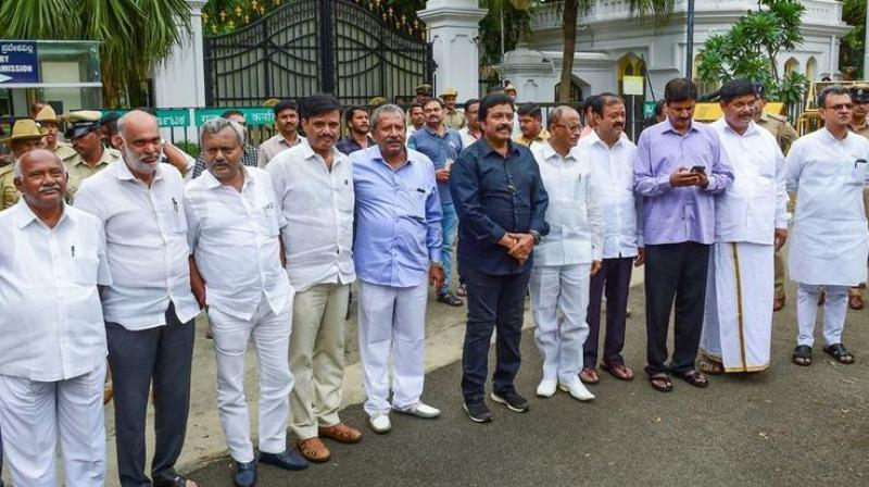 The lawmakers, who flew from Bengaluru to Mumbai after submitting their resignations on Saturday, alleged that the Speaker was deliberately sitting on their letters to help the Congress-JD(S) government. (Photo: PTI)