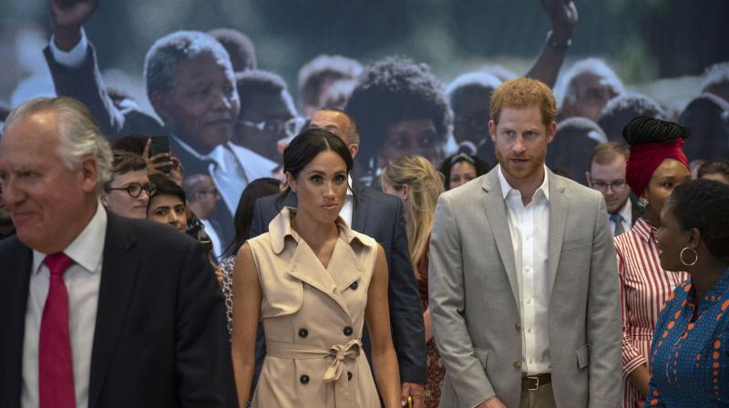 Britain's Prince Harry, center right, and Meghan the Duchess of Sussex attend the launch of the Nelson Mandela Centenary Exhibition, marking the 100th anniversary of anti-apartheid leader's birth, at the Queen Elizabeth Hall in London, Tuesday, July 17, 2018. (Photo: AP)