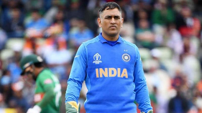 Former India cricketer Madan Lal said that it is MS Dhoni's call when he wants to make a comeback in the team but he should start playing domestic cricket. (Photo: AFP)