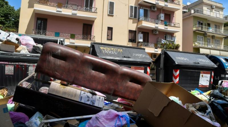 Some residents make matters worse by simply dumping their old mattresses, fridges and sofas next to garbage bins. (Photo: AFP)