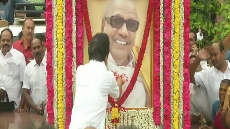 Stalin, along with his party cadres, showered the colossal photo of the demised leader with flowers. (Photo: ANI)