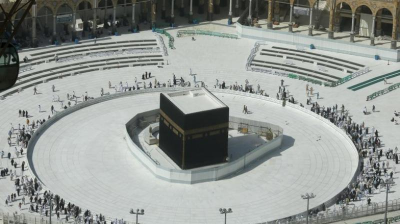 Muslims circumambulate the Kaaba, the cubic building at the Grand Mosque, in the Muslim holy city of Mecca, Saudi Arabia, on March 7, 2020