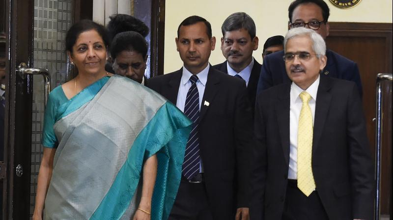 Finance minister Nirmala Sitharaman and  RBI Governor Shaktikanta Das arrive for the RBI central board of directors in a customary post-budget meeting, in New Delhi on Saturday. PTI photo