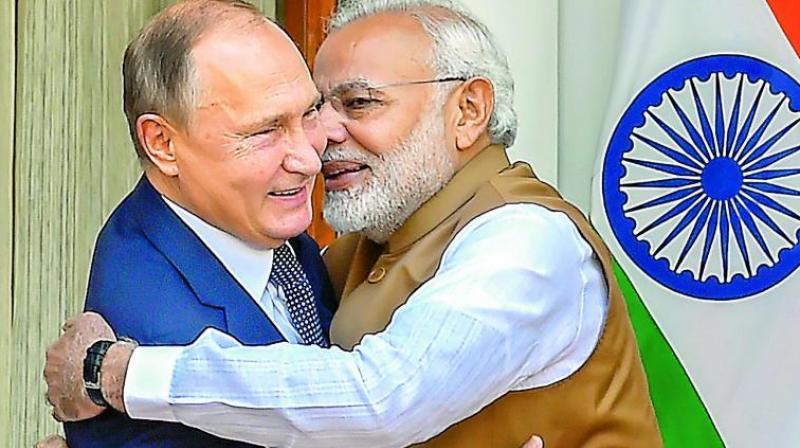 Prime Minister Narendra Modi hugs Russian President Vladimir Putin before their meeting at Hyderabad House, in New Delhi, on Friday. (Photo:PTI)