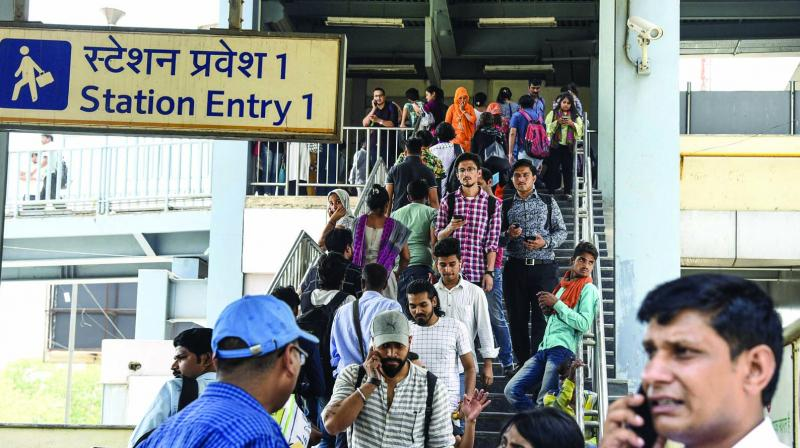 Passengers coming out from Chattarpur Metro Station after services got affected due to technical glitches on Tuesday. (Photo: PTI)