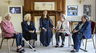 Kate Middleton interacts with Bletchley Park veterans during a special D- Day exhibition in the newly restored Teleprinter Building, marking the 75th anniversary of the D-Day landings. (Photo: AP/Heathcliff O'Malley/Pool Photo)