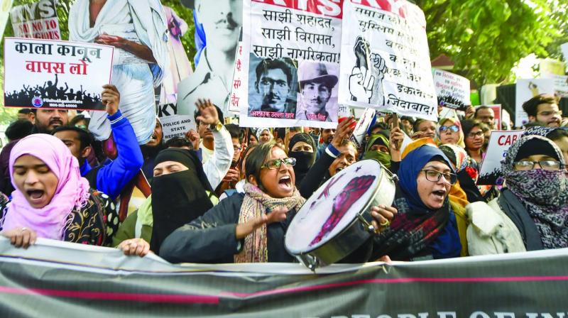 Activists and students of various universities on a protest march in New Delhi on Tuesday. (PTI, ASIAN AGE)