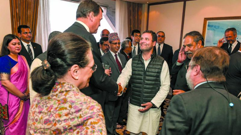 Rahul Gandhi greets the ambassadors/high commissioners of G-20 and neighbouring countries during a meeting in New Delhi. (Photo: PTI)