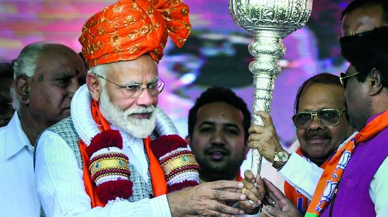 Prime Minister Narendra Modi is felicitated during a rally in Kalaburagi, Karnataka, on Wednesday. (Photo: PTI)