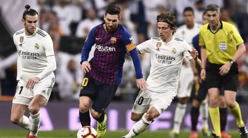 Barcelona and Real Madrid will face each other at Camp Nou for the first El Clasico of the 2019-20 season on December 18, La Liga confirmed on Wednesday. (Photo:AFP)