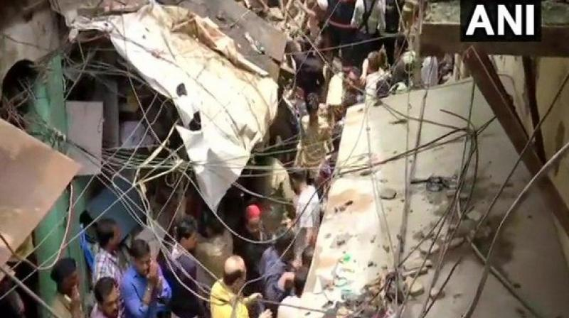 The building collapsed at 11 am on Tuesday on Tandel Street in Dongri area, initially killing two persons and trapping over 40 people under its debris. (Photo: ANI)